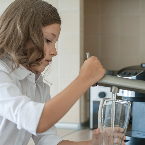 Young Girl Pouring Tap Water