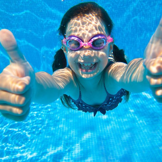 girl swimming in pool water